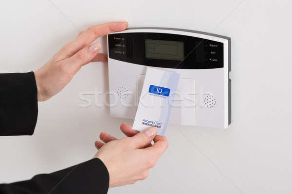 Woman Hand Holding Keycard To Open Door Stock photo © AndreyPopov