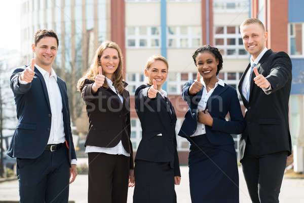 Group Of Businesspeople Showing Thumb Ups Stock photo © AndreyPopov