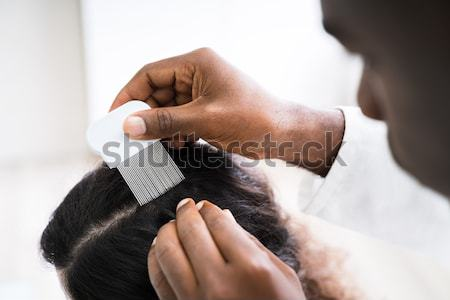 Person Using Lice Comb On Patient's Hair Stock photo © AndreyPopov