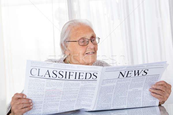Idős nő olvas újság boldog asztal Stock fotó © AndreyPopov
