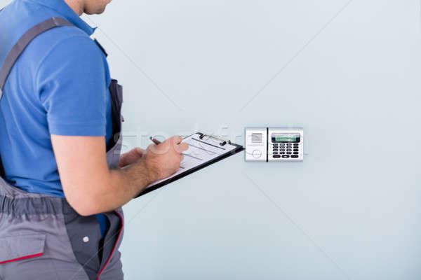 Male Technician In Overall With Security System Stock photo © AndreyPopov
