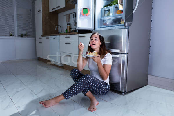 Woman Enjoy Eating Sweet Food In Kitchen Stock photo © AndreyPopov