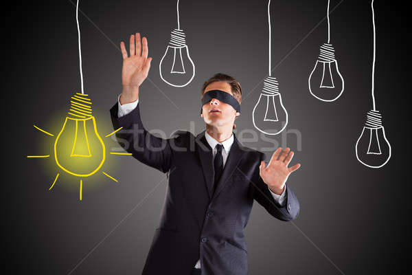 Stock photo: Blindfolded Businessman Searching For Bright Idea