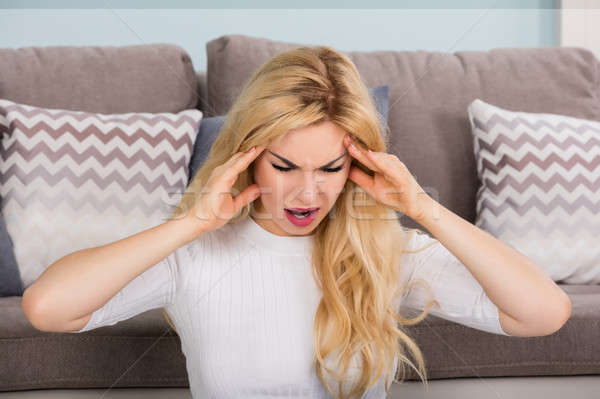 Woman Suffering From Headache Stock photo © AndreyPopov