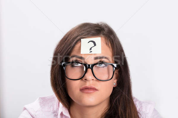 Sticky Note With Question Mark On Woman's Forehead Stock photo © AndreyPopov