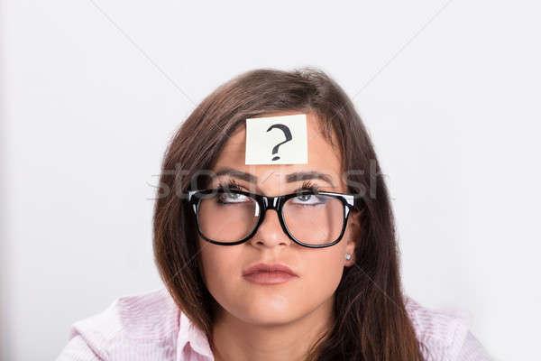 заметка вопросительный знак лоб женщину бизнеса Сток-фото © AndreyPopov