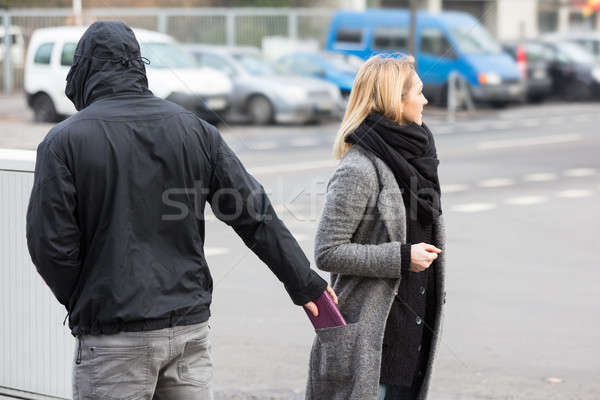 Man Stealing Purse On Street Stock photo © AndreyPopov