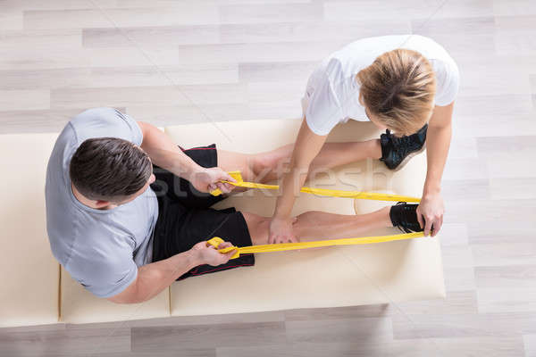 Female Physiotherapist Giving Exercise Treatment Stock photo © AndreyPopov