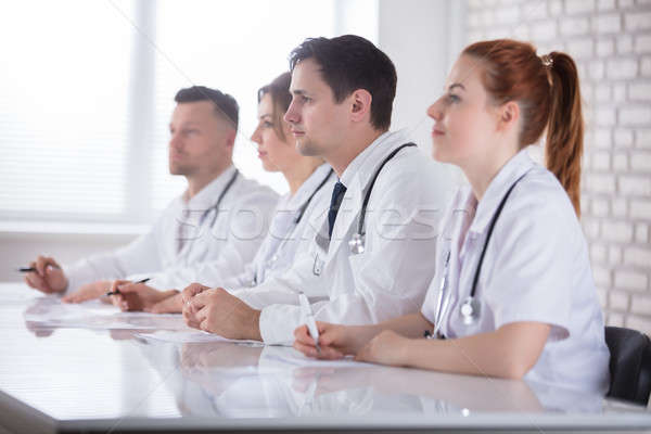 Professional Doctors Team In Meeting Stock photo © AndreyPopov