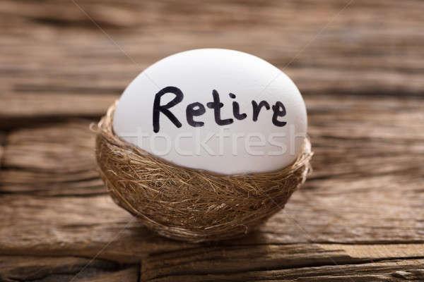 Retire Written On White Egg In Nest Stock photo © AndreyPopov