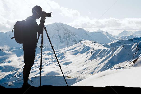 Silueta hombre invierno mochila luz Foto stock © AndreyPopov