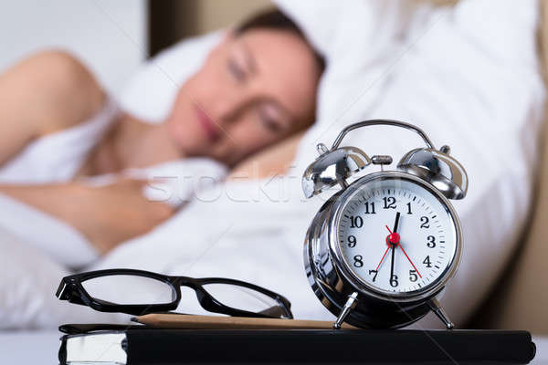 Eyeglasses And Alarm Clock On Table Stock photo © AndreyPopov