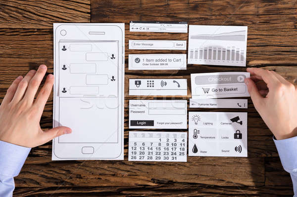 Designer mobil alkalmazás kilátás fejlődő papír Stock fotó © AndreyPopov