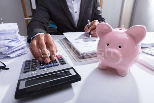 üzletember számla számológép közelkép persely asztal Stock fotó © AndreyPopov