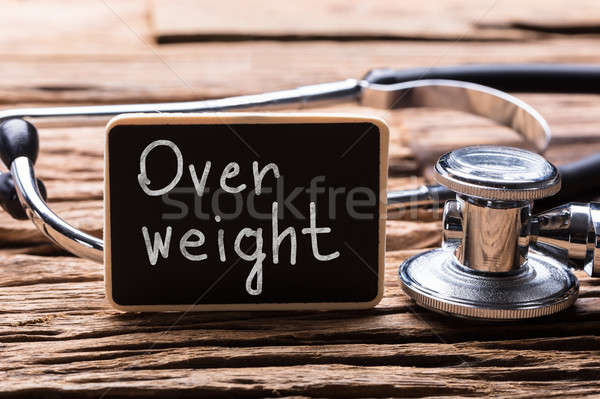 Close-up Of Stethoscope With Slate Showing Overweight Text Stock photo © AndreyPopov