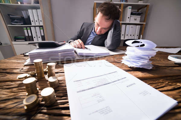 Stressed Businessman Working In Office Stock photo © AndreyPopov