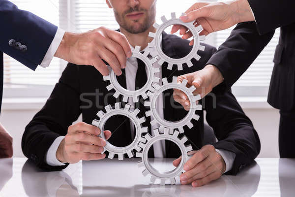 Group Of Businesspeople Stacking Gears Stock photo © AndreyPopov