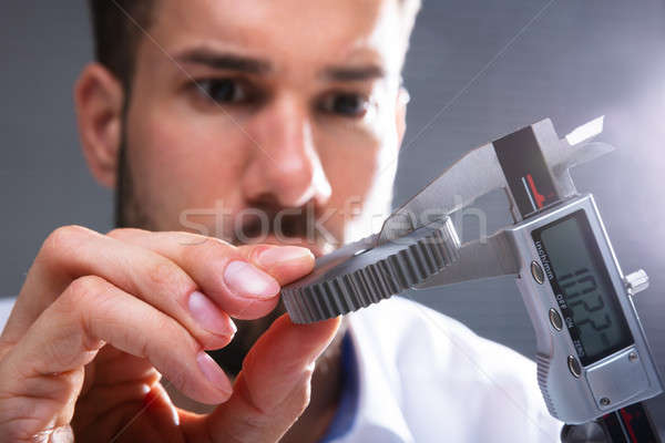 Man Measuring Gear's Size With Digital Caliper Stock photo © AndreyPopov