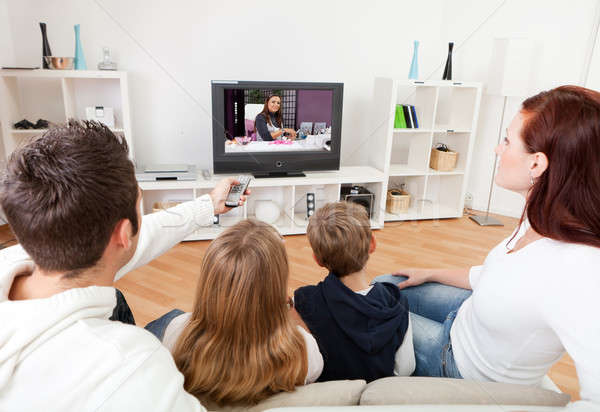 Young family watching TV at home Stock photo © AndreyPopov