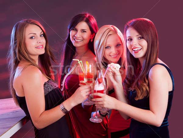 Heureux Homme amis célébrer groupe quatre Photo stock © AndreyPopov