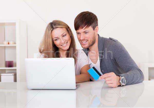 Couple shopping at online store Stock photo © AndreyPopov