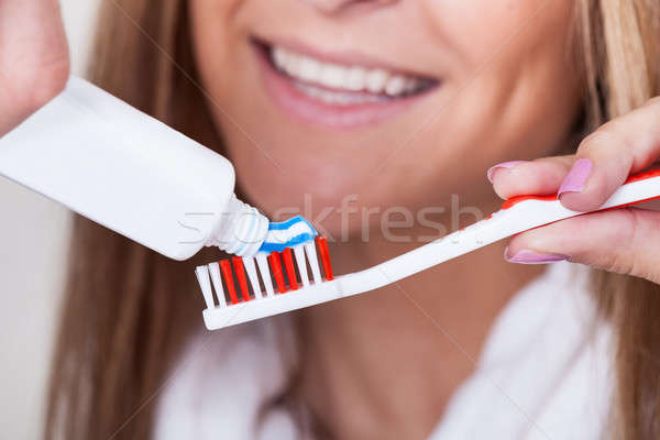 Maman dentifrice brosse à dents bleu rayé rouge Photo stock © AndreyPopov