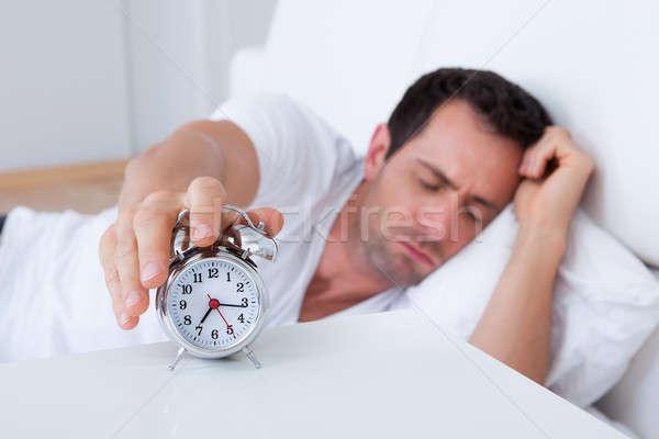 Wyczerpany człowiek budzik sypialni oka zegar Zdjęcia stock © AndreyPopov