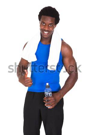 Happy African Athlete Holding Trophy Stock photo © AndreyPopov