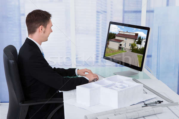 Stock photo: Architect Browsing Property On Computer In Office