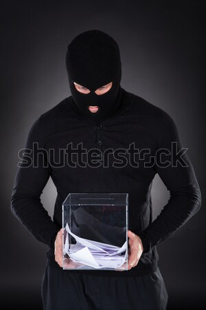 Thief stealing a laptop computer Stock photo © AndreyPopov