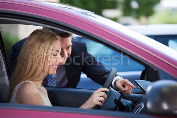 Salesman Showing Car To Customer Stock photo © AndreyPopov