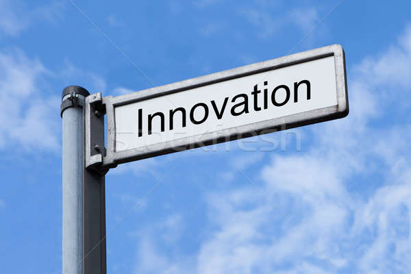 Signpost With Innovation Sign Against Sky Stock photo © AndreyPopov