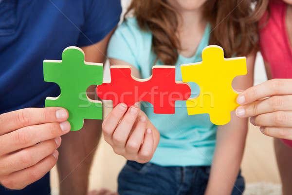 Stock photo: Family Joining Puzzle Pieces