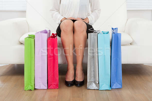 Woman With Multicolored Shopping Bags At Home Stock photo © AndreyPopov