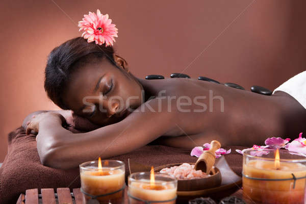 Woman Undergoing Lastone Therapy At Spa Stock photo © AndreyPopov