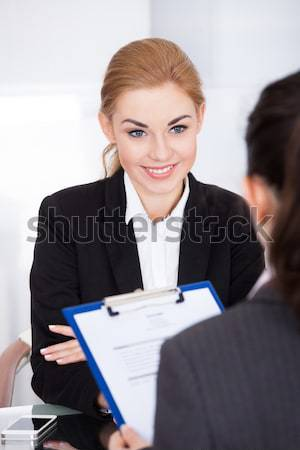 Businesswoman Conducting Interview Stock photo © AndreyPopov