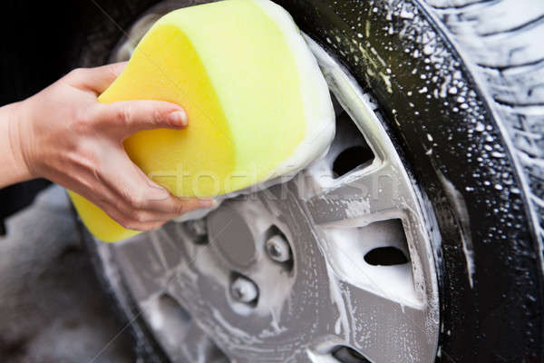 Hand Washing A Tire With Sponge Stock photo © AndreyPopov