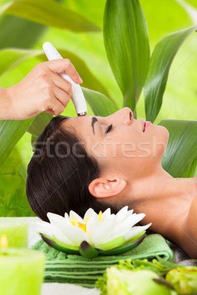 Woman Receiving Microdermabrasion Therapy Against Leaves Stock photo © AndreyPopov
