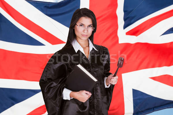 Stock photo: Portrait Of Female Judge With Book And Gavel