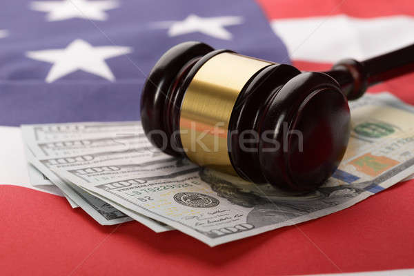 Gavel On Usa Dollar Banknotes And Us Flag Stock photo © AndreyPopov