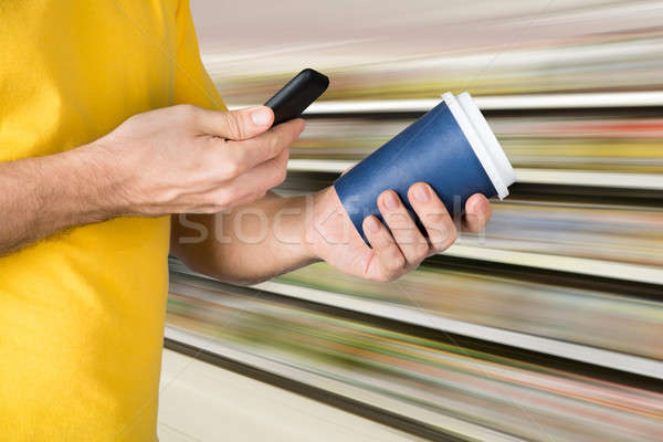 Man Scanning The Price On Takeaway Coffee Cup Stock photo © AndreyPopov