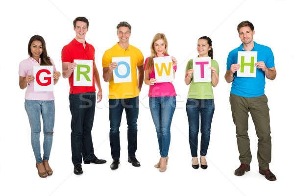 Több nemzetiségű barátok készít szó növekedés boldog Stock fotó © AndreyPopov
