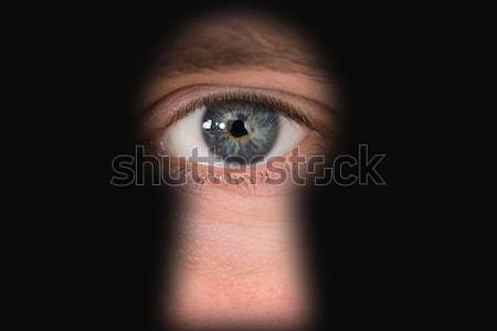 Person Looking Through Keyhole Stock photo © AndreyPopov