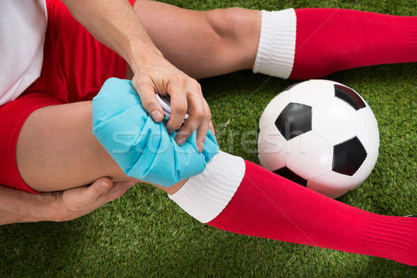 Soccer Player Icing Knee With Ice Pack Stock photo © AndreyPopov
