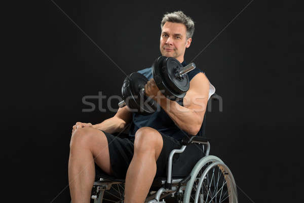 Handicapped Man On Wheelchair Working Out With Dumbbell Stock photo © AndreyPopov