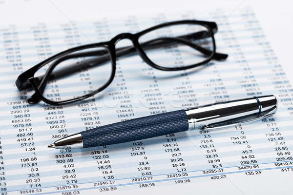 Financial Data Sheet With Eyeglasses And Pen Stock photo © AndreyPopov