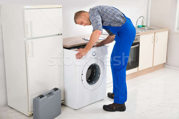 Man Repairing Washing Machine Stock photo © AndreyPopov