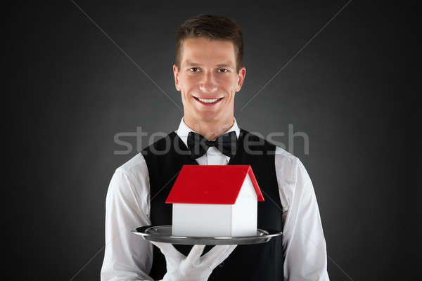 Butler Holding Tray With House Model Stock photo © AndreyPopov