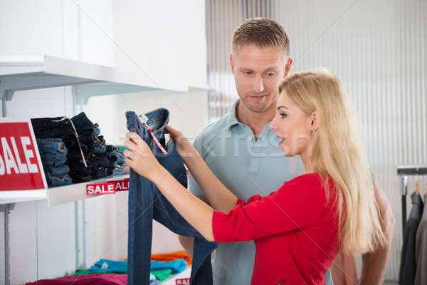 Man Standing By Surprised Woman Holding Jeans Stock photo © AndreyPopov