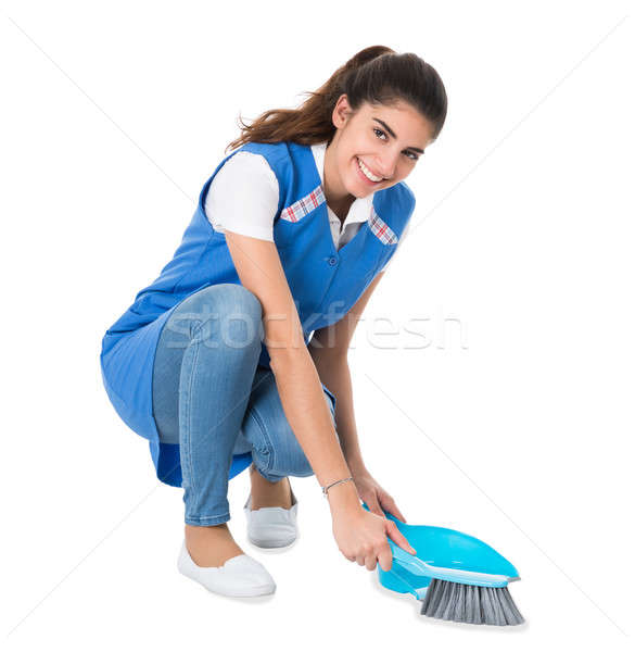 Cleaner Sweeping With Small Broom On White Background Stock photo © AndreyPopov